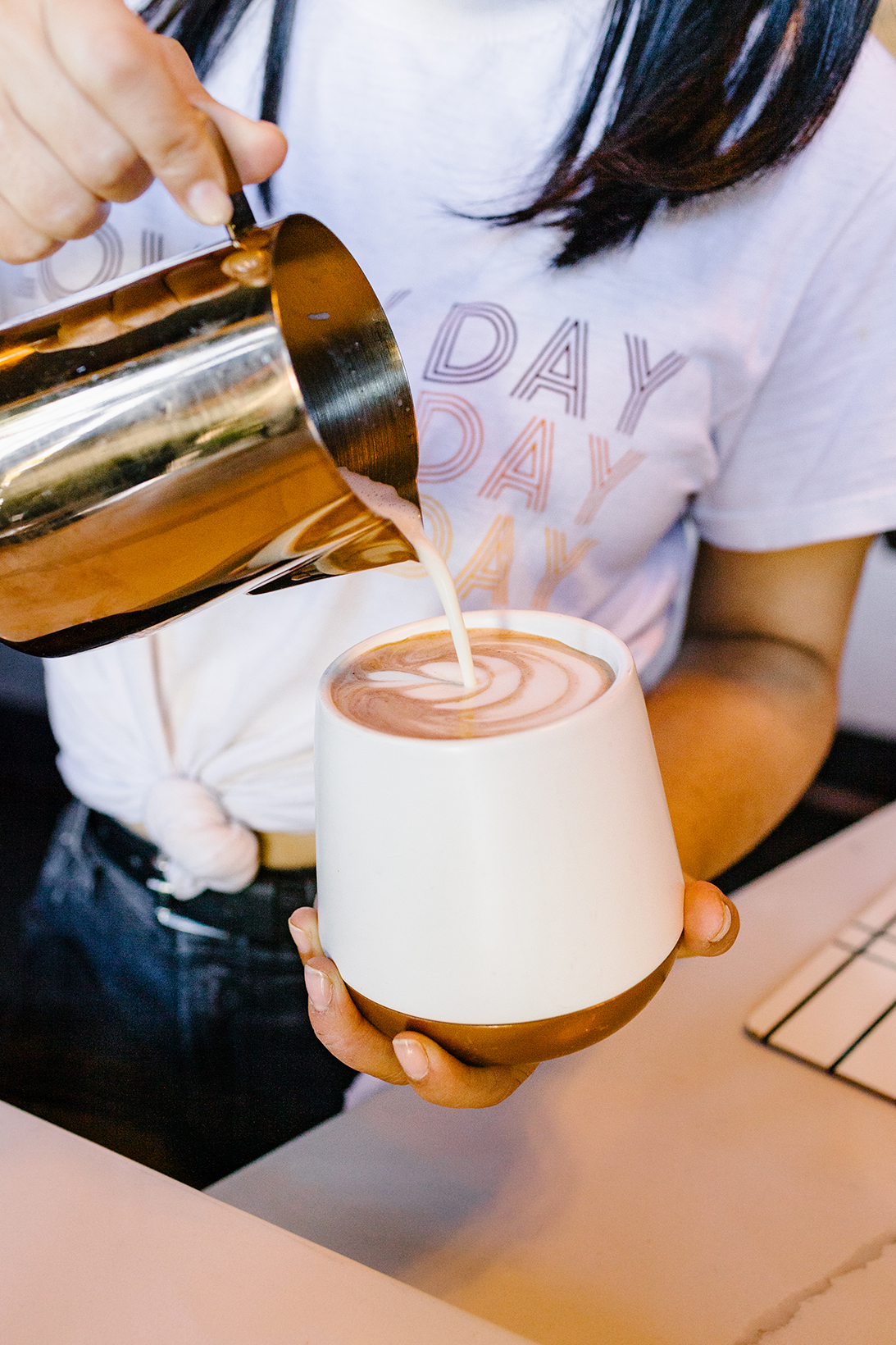 picture of a barista making a latte